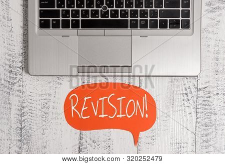 Writing note showing Revision. Business photo showcasing action of revising over someone like auditing or accounting Close view open laptop speech bubble downwards lying vintage table. poster
