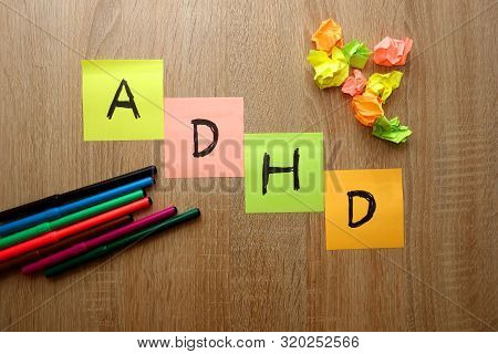 Adhd (attention Deficit Hyperactivity Disorder) Text Written On Colorful Sheets Of Paper