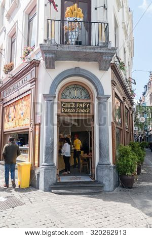 Brussels, Belgium - June 6, 2019: Entrance To Chez Papy Resto Snack Restaurant With Belgian Frites.