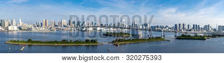 Panorama Aerial view of Tokyo skylines with Rainbow bridge and tokyo tower over Tokyo bay in daytime from Odaiba in Tokyo city Kanto Japan.