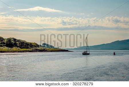 A Sail Boat Leaves Loch Aline Behind. Loch Aline Is A Small Salt Water Loch Home To Fish, Birds And