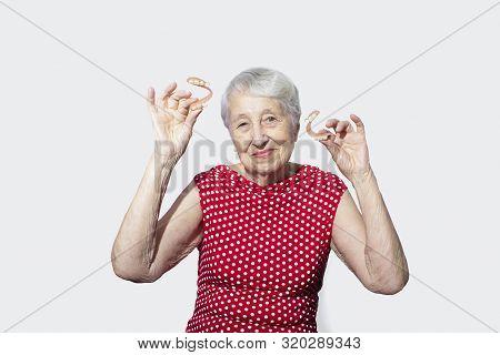 Flexible Nylon Denture On Senior Female Hands. Removable Dentures Flexible, Devoid Of Nylon, Hypoall