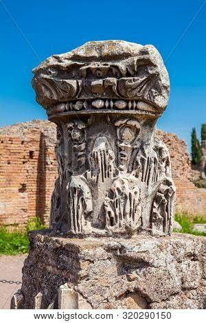 Remains Of Columns Of The Ancient Buildings At The Roman Forum In Rome