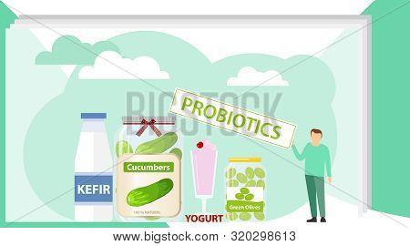 Probiotics, Natural Probiotics. A Man Demonstrates Natural Probiotics. Canned Cucumber, Green Olives