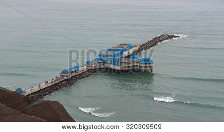 The Characteristic Blue Pier At The Pacific Coast In Miraflores, Lima, Peru