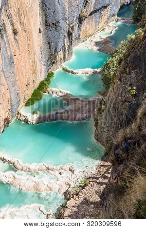 The Bright Blue Colored Natural Pools Of The Millpu Blue Lagoons, Ayacucho, Peru
