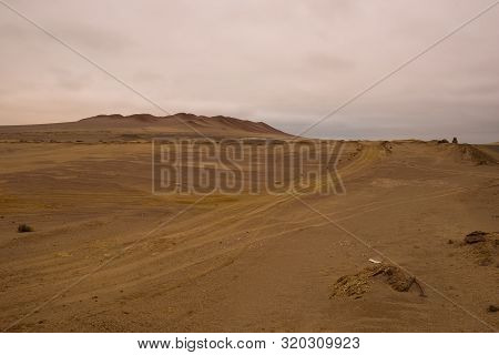 Yellow Sand Dunes And Red Mountains In The Desert Of Paracas National Reserve, Peru