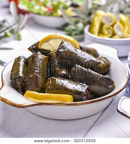 Traditional Greek Cuisine. Wrapped Rice In Grape Leaves. Dolma With Lemon And Spices. Home Cooked Fo