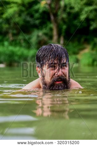 Summer Fun. Water Beast. Furry Monster. Wild Man. Time To Relax. Bearded Man Swimming In Lake. Summe