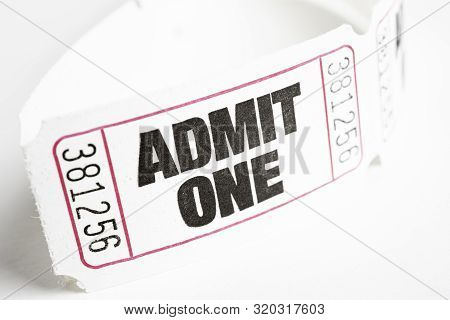 A macro or close-up shot of a strip of generic white sequentially numbered admittance paper ticket. poster