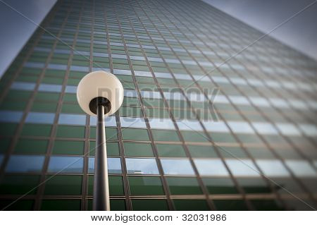 Lamp post in front office building facade