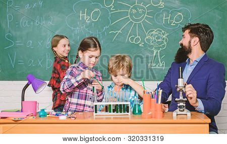 Science is always the solution. Observe reaction. School chemistry experiment. Fascinating chemistry lesson. Man bearded teacher and pupils with test tubes in classroom. Explaining chemistry to kids poster