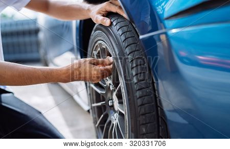 Maintenance Male Checking And Removing Tire Valve Filling Nitrogen Service On Street At Gas Station,