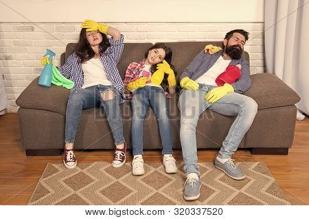 Tired Family. Exhausted Family After Cleaning House. Tired Family Hold Cleaning Products. Mother, Fa