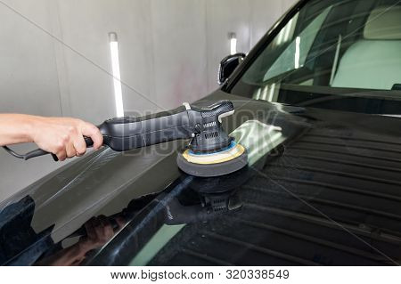 The Polisher Polishes The Body Of The Vehicle With Special Wax To Protect The Car From Minor Scratch