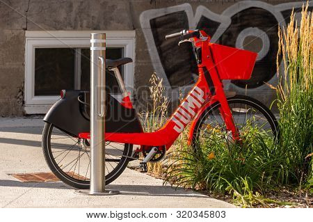 Montreal, Canada - 03 September 2019: Uber Jump Electric Bike Locked To A Bike Rack On Laurier Stree