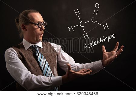 Professor Presenting Handdrawn Chemical Formula Of Acetic Acid Ch3cooh Molecule