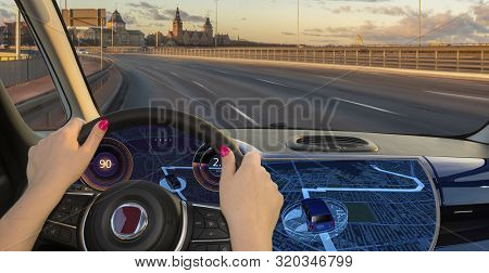 Woman Driving A Car Equipped With Active Safety Systems