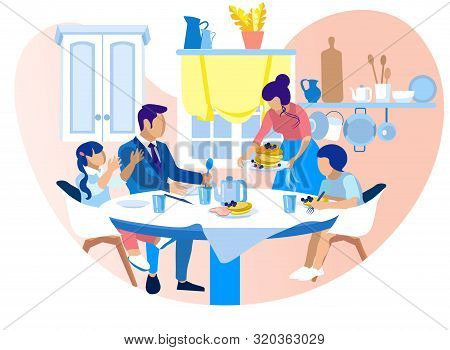 Happy Family Sitting Around Table On Kitchen Eating Tasty Breakfast. Mother Set Dishes, Father, Daug