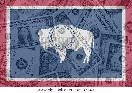 Us State Of Wyoming Flag With Transparent Dollar Banknotes In Background