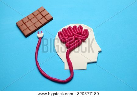 Figure Of Man And Bar Of Sweet Chocolate. Nutrition Brain Energy For Mind.