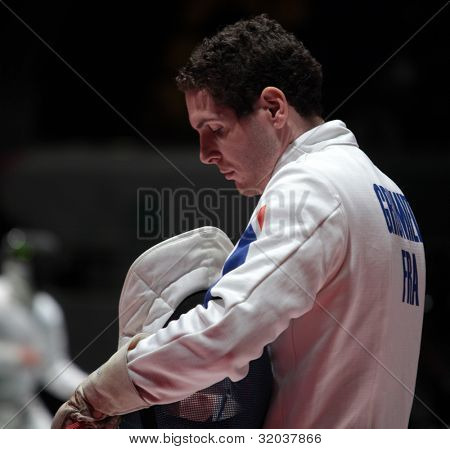 KIEV, UKRAINE - APRIL 14, 2012: Member of French team Gauthier Grumier before the fight during World Fencing Championship on April 14, 2012 in Kiev, Ukraine