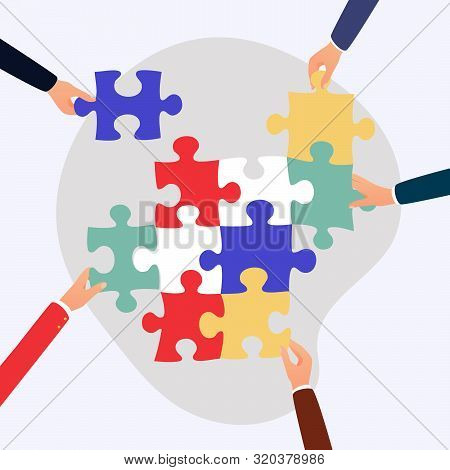 Concept Of Teamwork And Integration With Businessman Holding Colorful Puzzle.