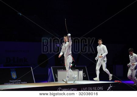 KIEV, UKRAINE - APRIL 14, 2012: Italian team go to podium before the match for 3rd place during World Fencing Championship on April 14, 2012 in Kiev, Ukraine