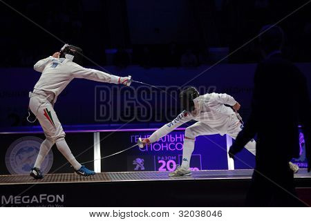 KIEV, UKRAINE - APRIL 14, 2012: Fight between Gabor Boczko, Hungary, and Diego Confalonieri, Italy, during World Fencing Championship on April 14, 2012 in Kiev, Ukraine