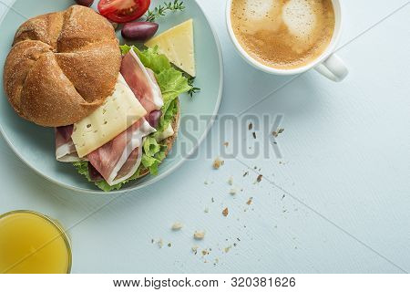 Breakfast Served With Coffee, Juice, Sandwich With Ham, Cheese, Tomato And Lettuce. Continental Deli