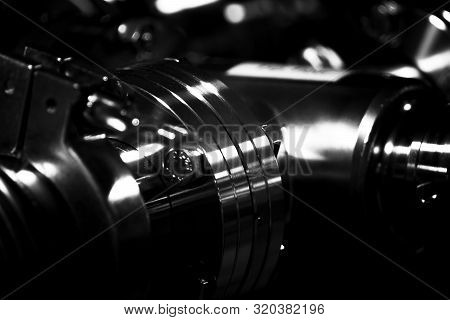 Close-up: The Vacuum Tube System Against A Dark Background