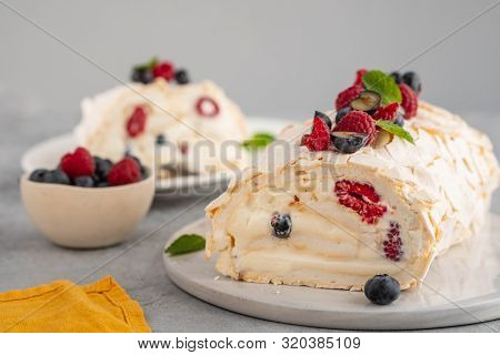 Meringue Roll Cake With Cream And Raspberries. Roulade, Summer Dessert, Closeup.