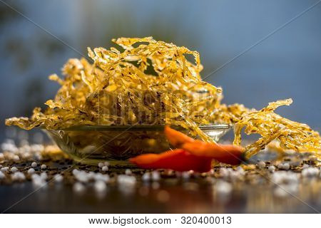 Famous Indian And Gujarati Snack Dish In A Transparent Glass Plate Isolated On The Wooden Surface I.