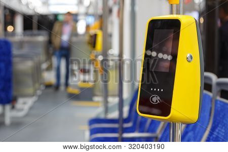 Bus With Validator For Self-payment. Fare Control Without A Conductor. Non-cash Transport Payment. T