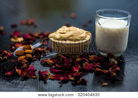 Multani Mitti Or Fuller's Earth Or Mulpani Mitti Face Mask On Wooden Surface In Glass Bowl Consistin