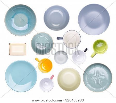 Colorful plates, bowls, cups and mugs isolated on white background