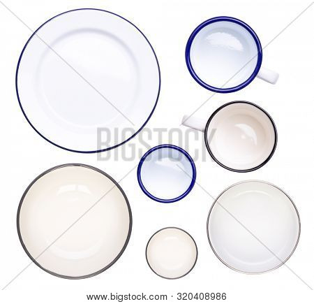Enamel plates, bowls, cups and mugs isolated on white background