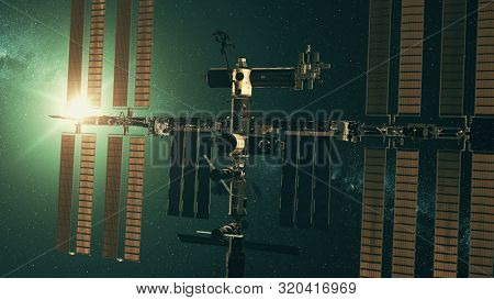 Modern International Space Station with solar panels in outer space against green star light. 3d render animation. Science and technology concept. Elements of this media furnished by NASA