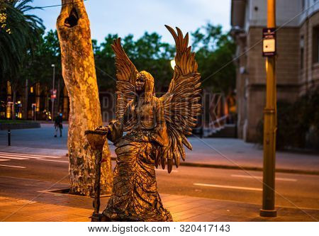 Barcelona, Spain – 2019. Living Statue On Rambla In Bacelona. Travel Photo In Barcelona One Of The M