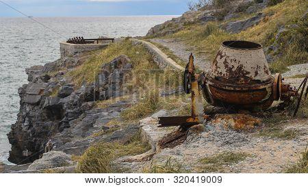 Mortar Grinder On Sea And Land Background