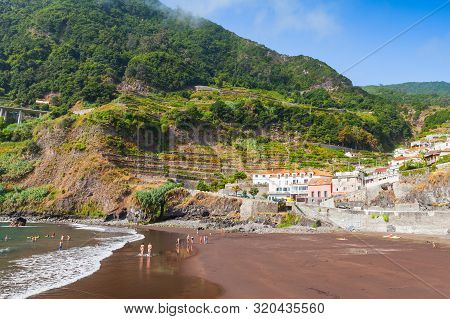 Seixal Beach With Resting People. Landscape Of Madeira Island, Portugal