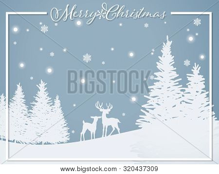 Paper Art Carving Of Deer On The Hill Near The Pine Tree Under Snowflake And Merry Christmas Text On