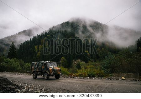 Military Truck Of The Defense Forces Of Georgia Drives Near The Border Of South Ossetia Against The