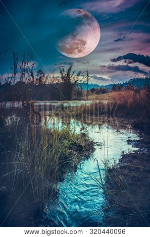 Landscape At Night Time In The Forest Lake With Fogy And Darkness Sky Super Moon In The Background.t