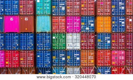 Freight Shipping Containers At The Docks, Stack Of Containers In A Container Ship At Deep Sea Port.