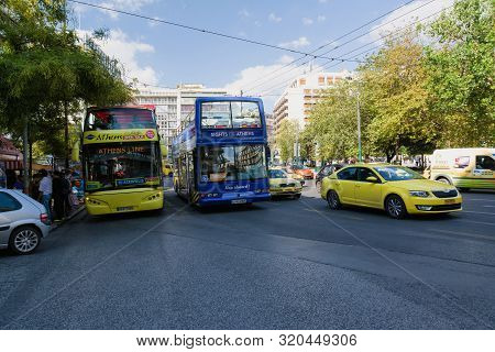 Athens, Greece- September 23, 2016: Tourist Sightseeing Double Decker Busses In Athens, Greece. Athe