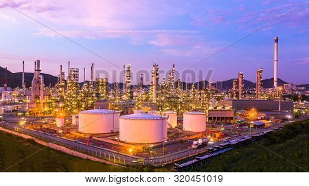 Oil Refinery And Petrochemical Plant Industrial Working With Fire And Blue Sky Background, Aeria