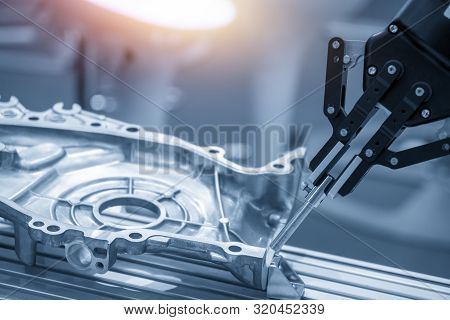 The Operation Of Robotics Arm In Automotive Parts Production Line For Quality Control Process. The H