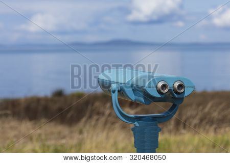 A Beach Telescope On The Beach Overlooking Harbor At Whidbey Island, Oak Harbor, Washington