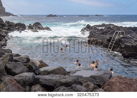 Ponta Da Ferraria, Azores, Portugal - August 7, 2019: Unidentified People Bathing In Natural Volcani